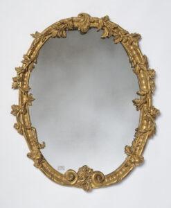 Decorative mirror with gold leaf ornamentation